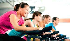 In the gym, exercising their legs doing cardio training